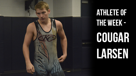 Senior Cougar Larsen prepares for a match with one of his teammates.