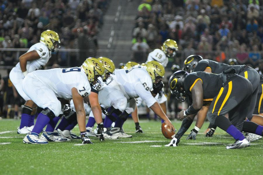 Tigers get ready to hike the ball to #34 at the start of the play.
