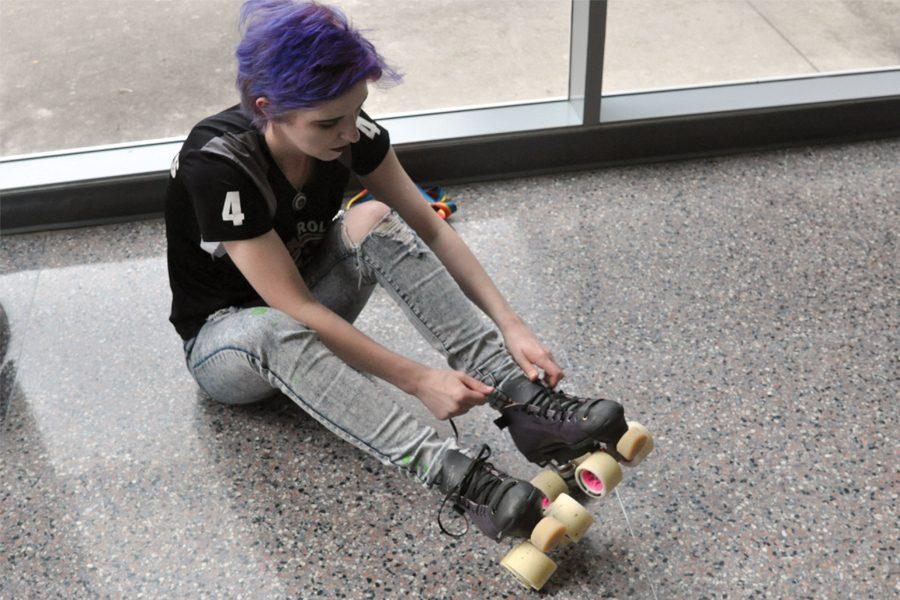 Senior+Sydney+Christofferson+puts+on+her+roller+skates.+%22My+favorite+thing+about+roller+derby+is+the+people+because+it%27s+inclusive+and+they+accept+everyone%2C%22+Christofferson+said.+