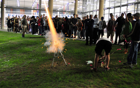The members of ROTC shoot off a rocket at their fall festival.