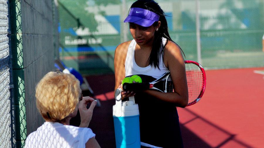 Senior Jasmin Tran prepares for her next match.