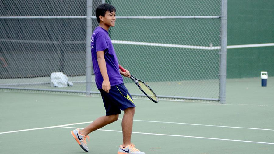 Junior+Ralph+Lee+practices%2C+working+to+perfect+his+tennis+skills.