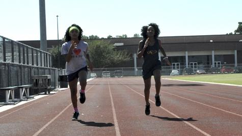Twins Katiana and Ariana Pulido practice on the track together after school.