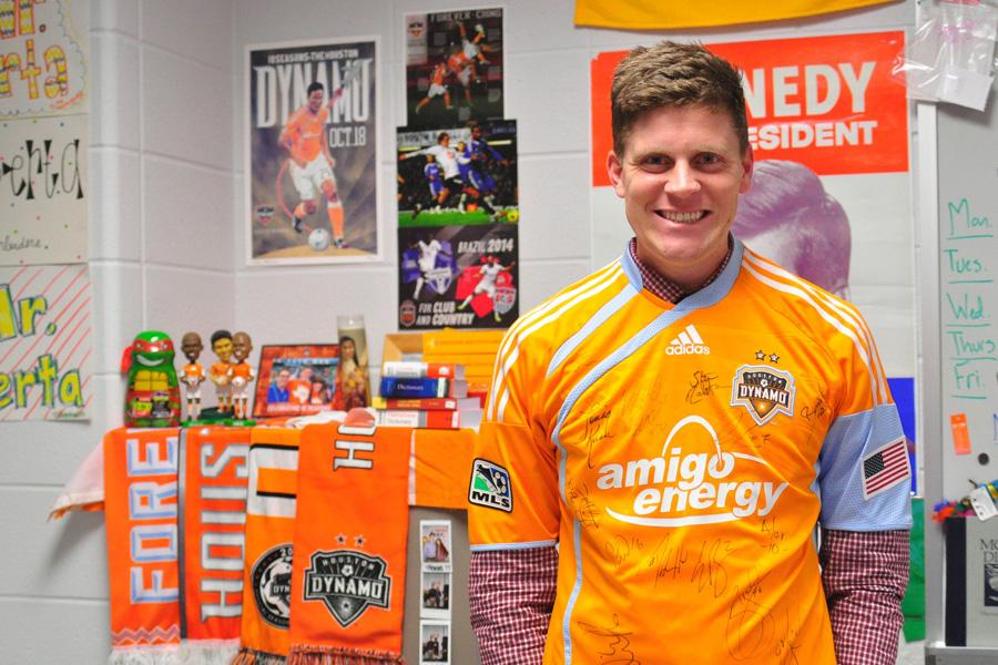 4.	U.S. History teacher Gordon Berta poses in front of his collection of Dynamo gear. This collection includes bobble heads, posters, scarves, a mug and the jersey he is wearing.