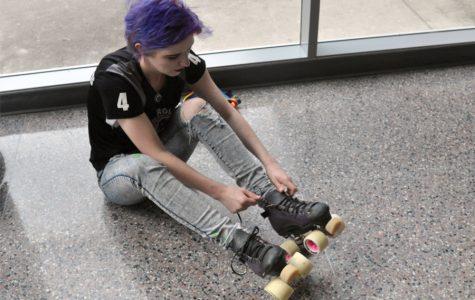 Senior Sydney Christofferson puts on her roller skates.