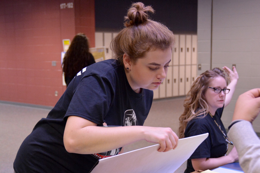 During the VASE competition, junior Emily Peropat guides contestants to the proper room for judging.
