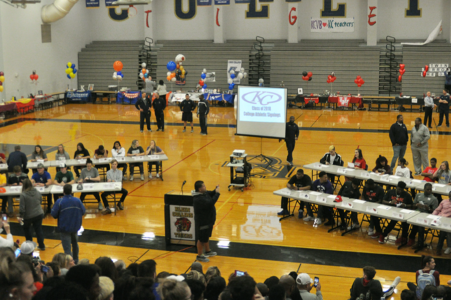 Athletes+prepare+to+sign+and+speak+to+the+student+body+about+their+thanks+and+excitement+to+sign+to+their+respective+colleges.