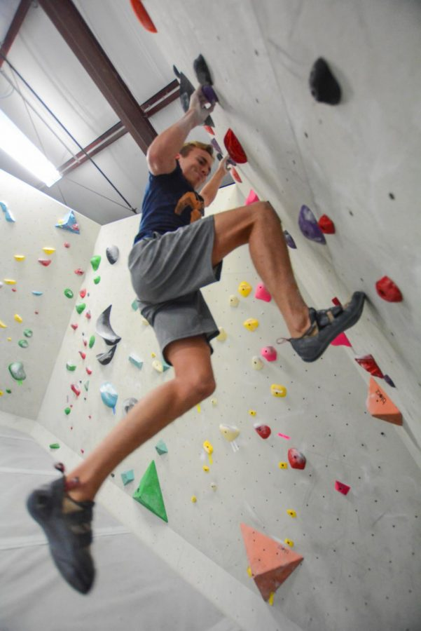 """Trying to """"send"""" the route on the rockwall, senior Max Maisonneuve struggles, every muscle in his body strained and shaking. """"But I won't give up,"""" Maisonneuve said. """"I'll keep trying until I get it, and I'll push myself on every route I try."""""""