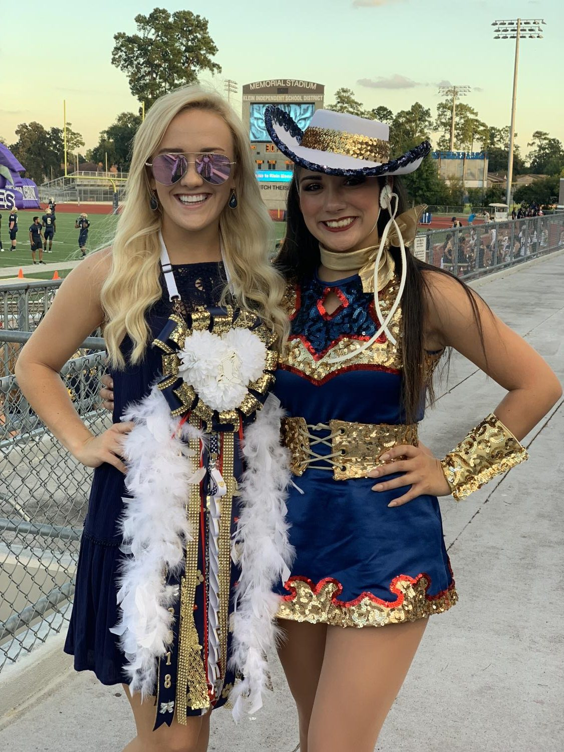 Olivia Thompson (left) celebrated the homecoming game with junior Teslyn DeLeon (right). Thompson has taught dance for eight years and has been a performer for 22 years.