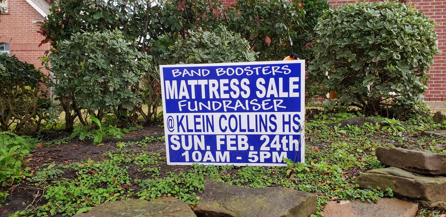 A sign of the upcoming mattress sale on Feb. 24.