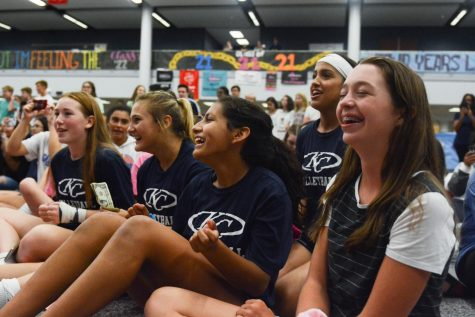 A group of freshmen watch the seniors perform their group dance before the senior auction, which allows the freshmen to