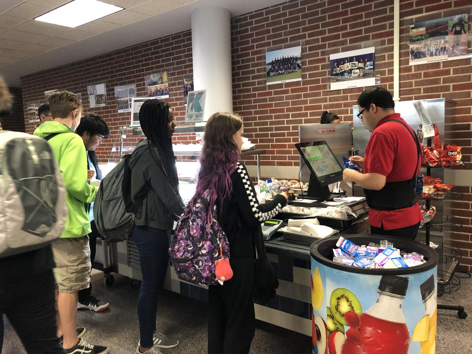 Students line up to buy lunch from the new line in the cafeteria.