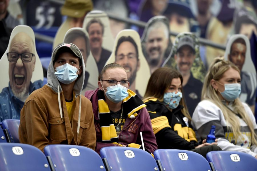 In this Nov. 1, 2020, file photo, spectators wear face masks to protect against COVID-19 during the first half of an NFL football game between the Baltimore Ravens and the Pittsburgh Steelers, in Baltimore.