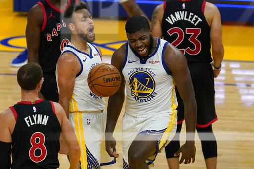 Golden State Warriors forward Eric Paschall (7) celebrates after scoring against the Toronto Raptors with guard Stephen Curry during the second half of an NBA basketball game in San Francisco, Sunday, Jan. 10, 2021. (AP Photo/Jeff Chiu)