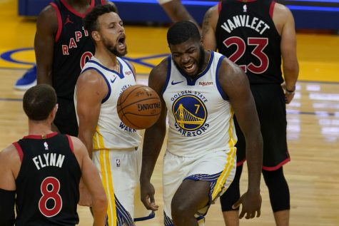 Golden State Warriors forward Eric Paschall (7) celebrates after scoring against the Toronto Raptors with guard Stephen Curry during the second half of an NBA basketball game in San Francisco, Sunday, Jan. 10, 2021.