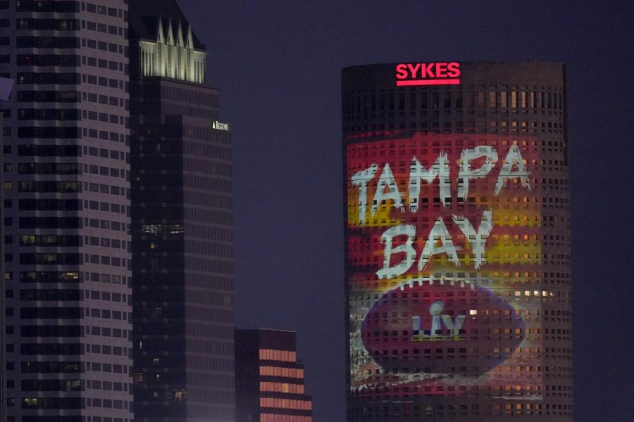 Signage for Super Bowl 55 is projected on a building in downtown building in Tampa, Fla. Thursday, Feb. 4, 2021. The city is hosting Sunday's Super Bowl NFL football game between the Tampa Bay Buccaneers and the Kansas City Chiefs.