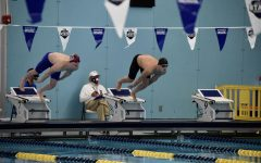Senior Samuel Wittmer dives off the block for the 50 freestyle at the 2021 UIL State competition.