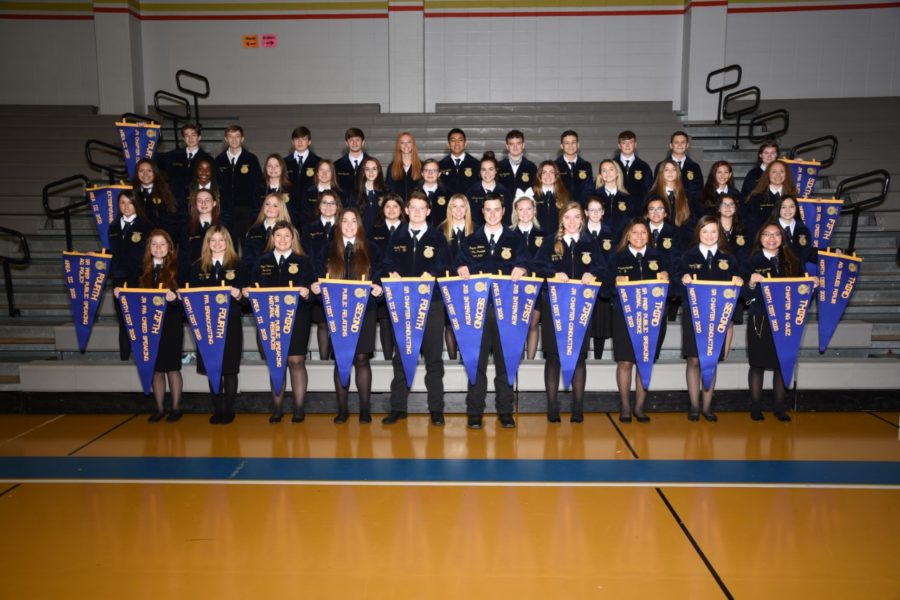 FFA+members+proudly+show+off+their+award+pennants.